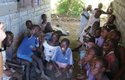 Kids hanging out in the shade at the clinic.