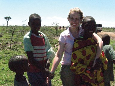 Masai children came out of nowhere to visit while our drivers fixed the flat tires on our way to the Masai Mara. They were amazed with Becky's white skin.