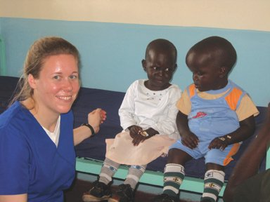 Medical student Teresa Czaplicki cares for siblings who look at each other with unsure glances.