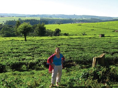 The author standing in front of a tea plantation in the mountains of Kenya. Best tea ever.