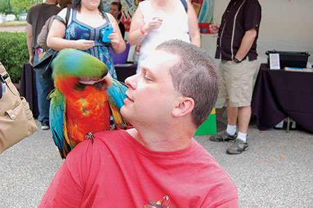 Photo-7---Torry-Sandlin-has-a-heart-to-heart-with-Harlequin-Macaw,-Kool-Aid.jpg