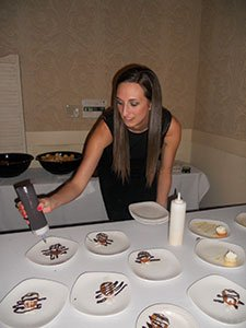 Abby-Salvino,-owner-of-Salvino-Dolci-Bakery,-decorates-her-pastries..jpg