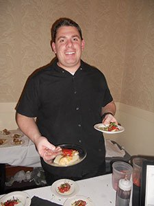 Chef-Joe-Gallagher,-of-D'Agnese's,-serves-artichoke-hearts-in-lemon-butter-and-crostini-with-olive-oil,-sausage,-tomato-and-micro-greens..jpg