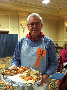 Celebrity-server-Attorney-Patrick-Weschler-offers-pizza-to-guests..jpg