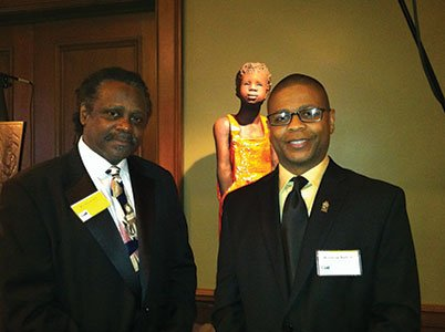 Honoree-Woodrow-Nash-and-his-son,-Woodrow-Nash-Jr.,-in-front-of-Nash's-sculpture.jpg