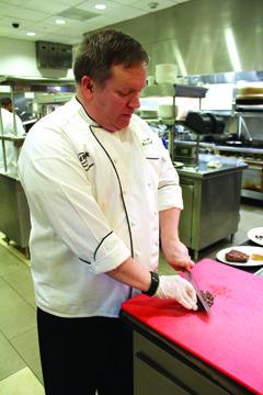 Chef cutting steak.jpg