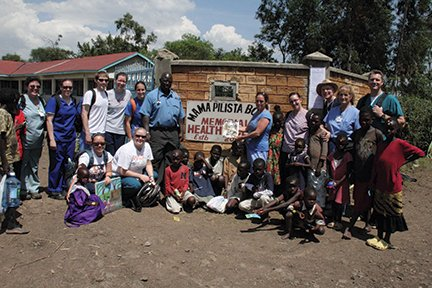 A group of us standing at the gate of the Mama Palista clinic. I'm holding a copy of akronlife..jpg