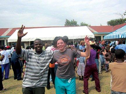 Interpreter Oron Isaac and medical student Amy Leidal enjoy the concert..jpg