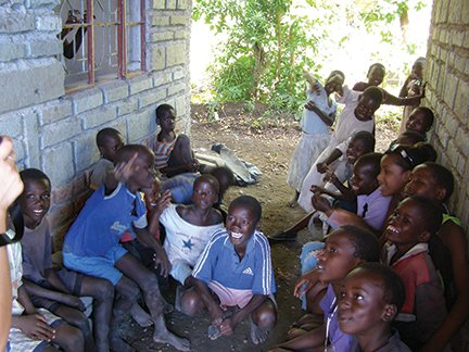 Kids hanging out in the shade at the clinic.JPG