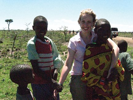 Masai children came out of nowhere to visit while our drivers fixed the flat tires on our way to the Masai Mara. They were amazed with Becky's white skin..JPG