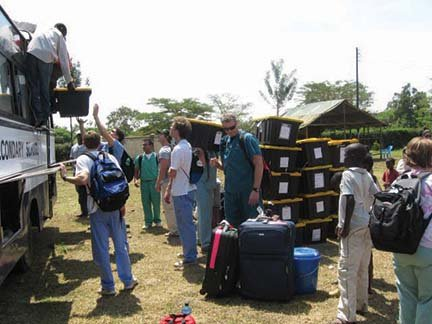 Unloading medical supplies we brought from the US to the clinic..JPG