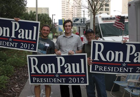 Altman (center) joins other Ron Paul supporters he met in Tampa.JPG