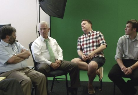 Altman (far right) and another student listen to UofA professor Mark Weaver (far left) and Bill Johnson, a U.S. Represen.JPG