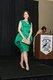 Jessica Burkhart-Zuschin modeling a popular peplum style dress and spiked heels of the 1960 era.jpg