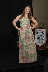 Rachel Myers (Goodwill Volunteer) wearing a floral 1970s dress.jpg