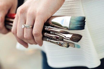 holding paintbrushes.jpg